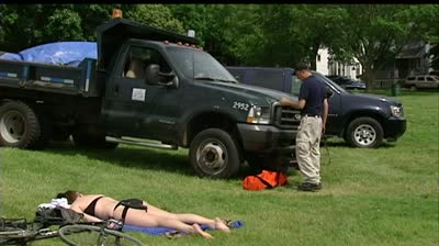 City truck runs over sunbather at Madison park