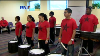 Boys and Girls Club Drumline march on
